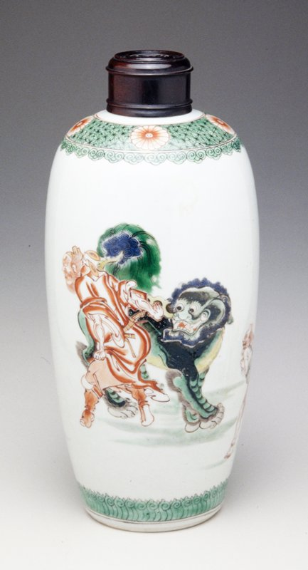 famille verte oviform vase; Kangxi iron red and gilt warrior watching sword upright in ground; Buddhistic lion and mythical figure by rocks; gilt seal mark above; shoulder with chrysanthemum heads on cell pattern