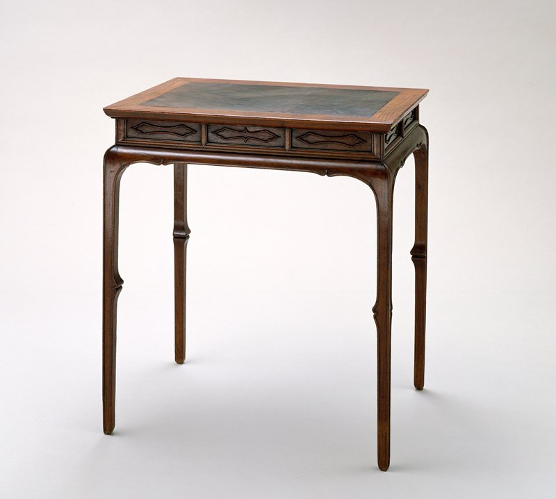 small rectangular table; hidden drawer at short side; burlwood top framed with huang hua-li; short apron and tin legs with joints at the knee