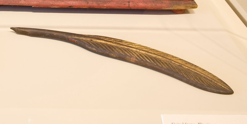 replica of a feather quill pen, gold