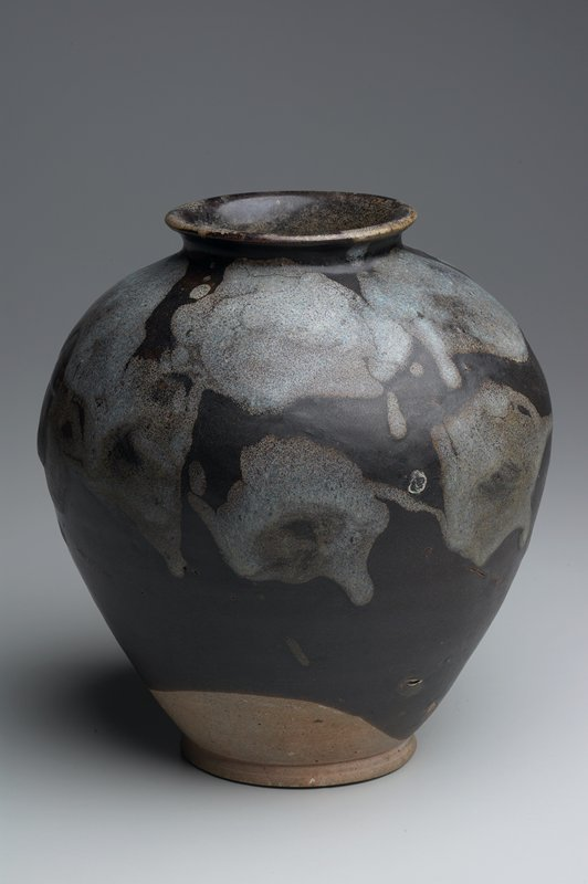 dark brown glaze splashed with pale blue on the vessel's shoulder; rare phosphatic glaze; unglazed foot