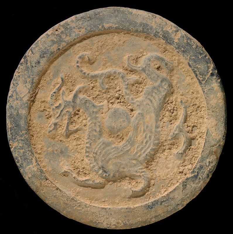circular disk carved on one side with dragon