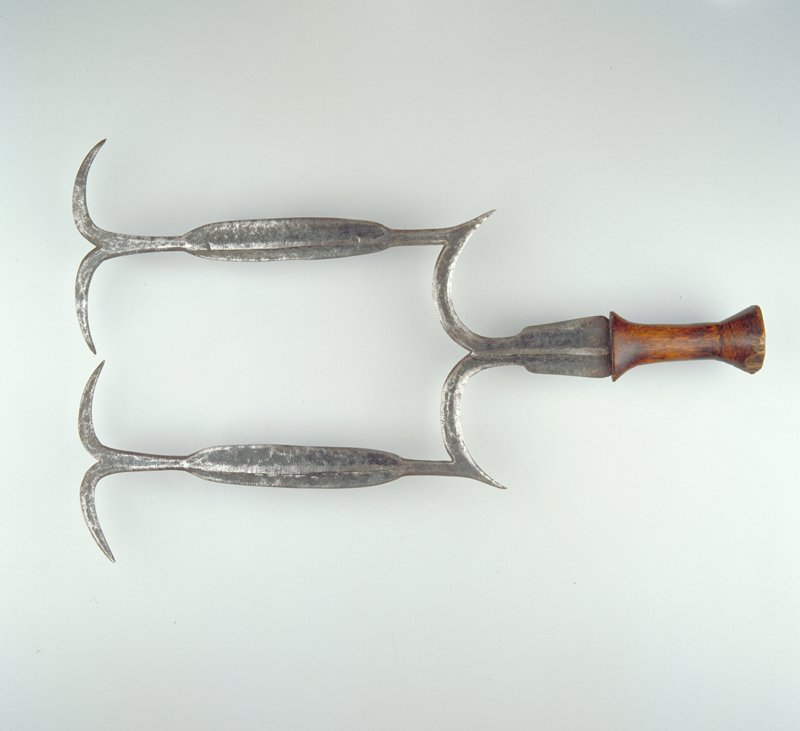 two vertical blades, each with two horizontal arches at top; wood handle; blades form open rectangle