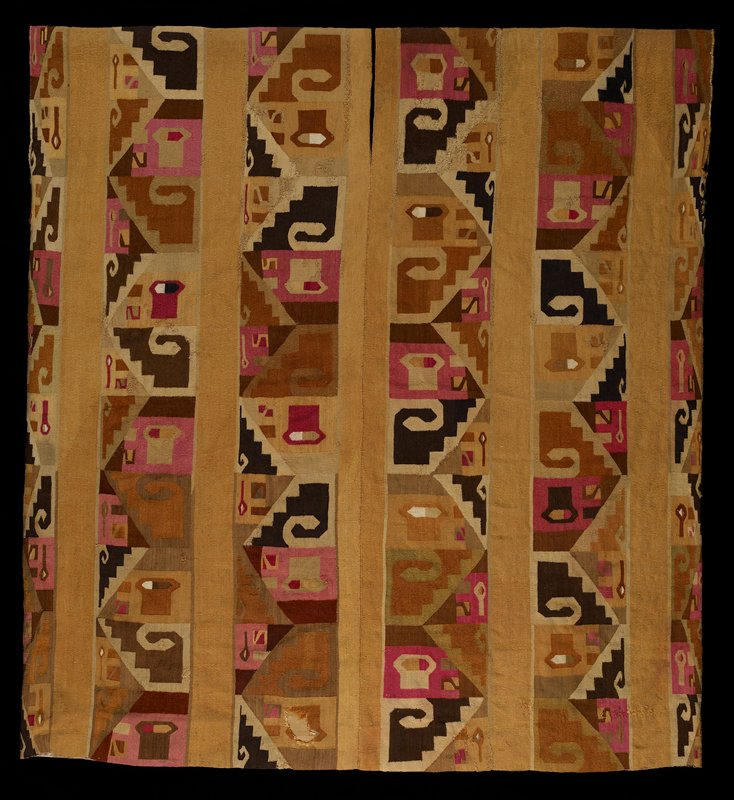 interlocked tapestry, made in two pieces but woven perpendicular to way it would be worn, seamed down the middle; predominate colors ochre, tan pink, dark brown; one blue area, two red areas; repeated 'puma' motif