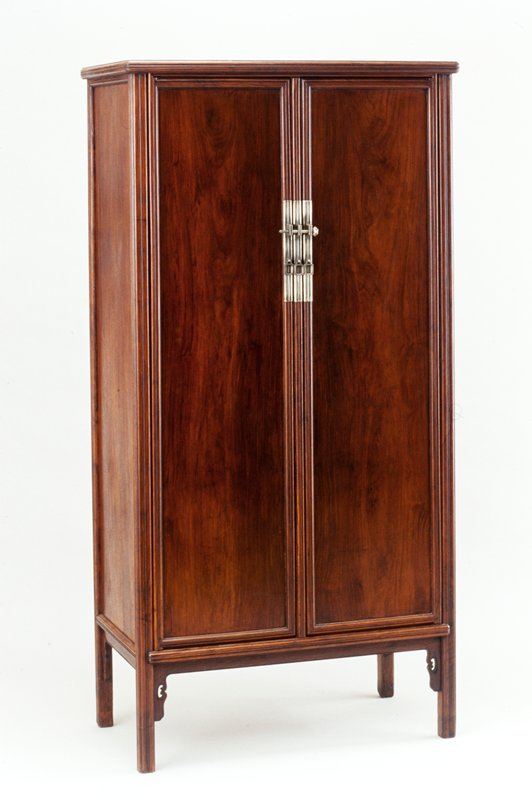 large rectangular huang hua-li cabinet; two doors, removable center mullion; two drawers, three shelves; front and sides tapered toward top