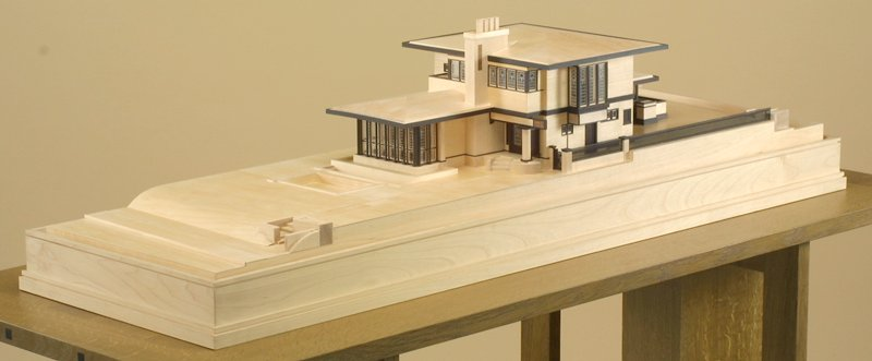 1/4 in. to 1 foot scale model ot the Purcell-Cutts House in two toned wood encased in a plexi vitrine on a wood plinth