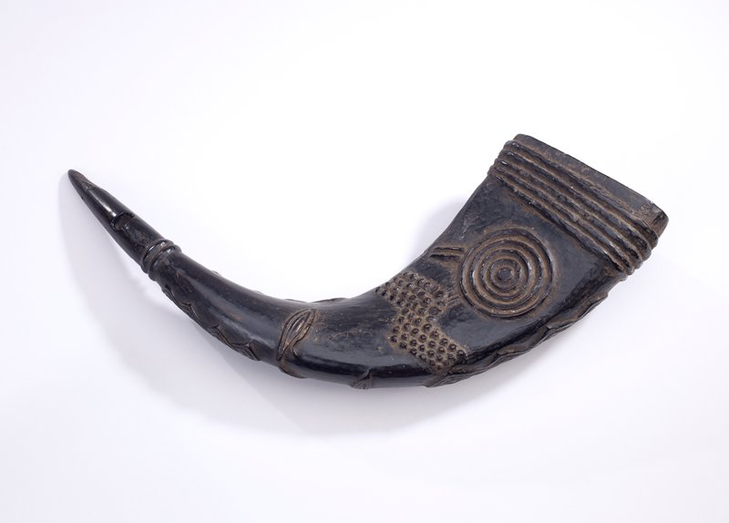 horn carved with geometric and organic patterns overall