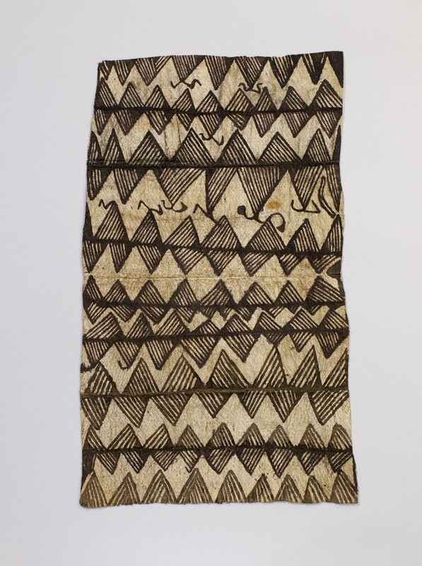 irregularly rectangular-shaped piece of tan barkcloth with brown horizontal designs of triangles with parallel lines inside their borders and several organic swirls
