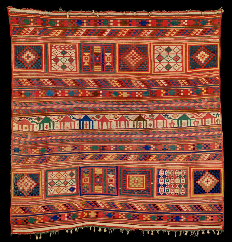 Red ground with white blue green yellow brown in geometric patterning; center band has white ground with large and small camels and human figures (?)
