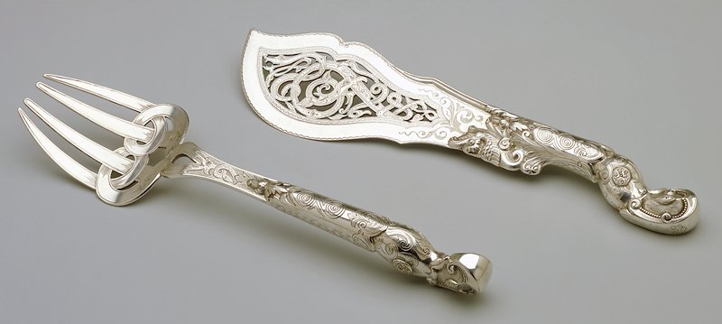 ornate handles; pierced blade
