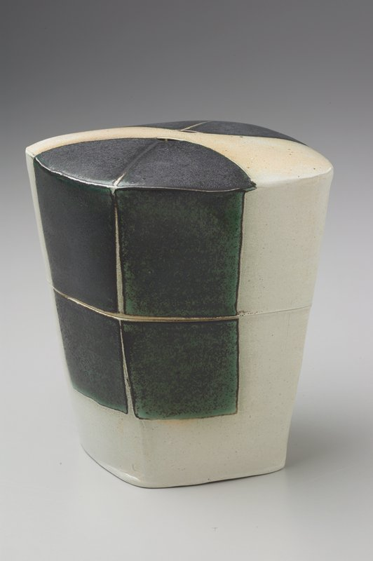 diamond-shaped box, slightly flaring from base; 2 small football-shaped holes at center of lid; interior glazed green; exterior glazed white with green at 2 corners on lid and sides of box