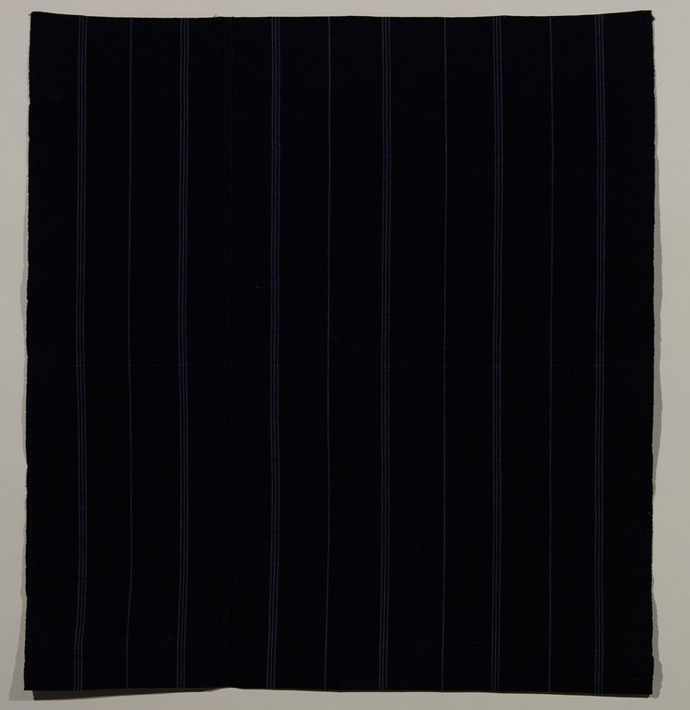 """indigo with light stripes; one piece skirt sewn at one side; 11"""" high band sewn at top of skirt"""