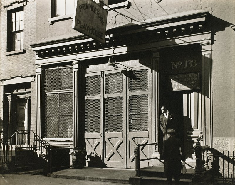 "black and white; front of building with sign: ""Provincetown Playhouse""; two men at right"