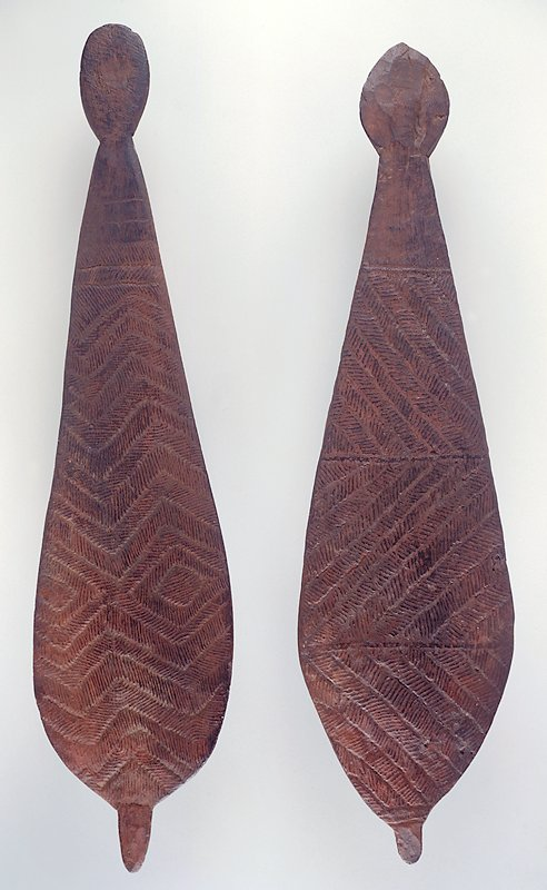 Paddle-shaped object; small protrusion on widest end; decorated with incised horizontal hatched rows of zigzags and two diamonds