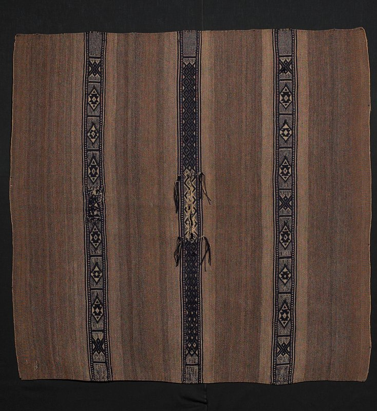 """blue supplementary weft patterning; 3 stripes on light brown wool background; vertical 10"""" long neck opening in central part for head"""