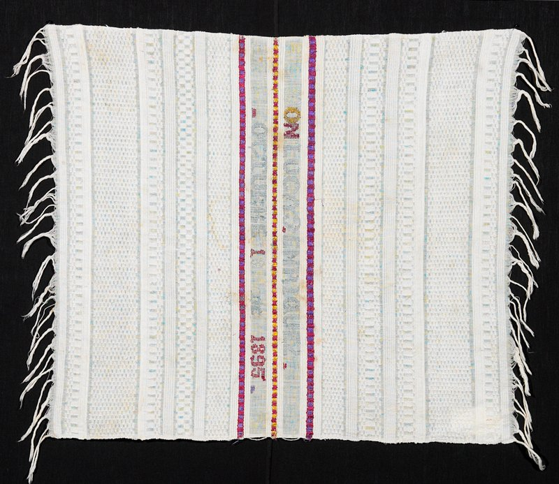 supplementary weft patterning and cut; inscription woven in the center with red, purple, blue, yellow silk on white ground
