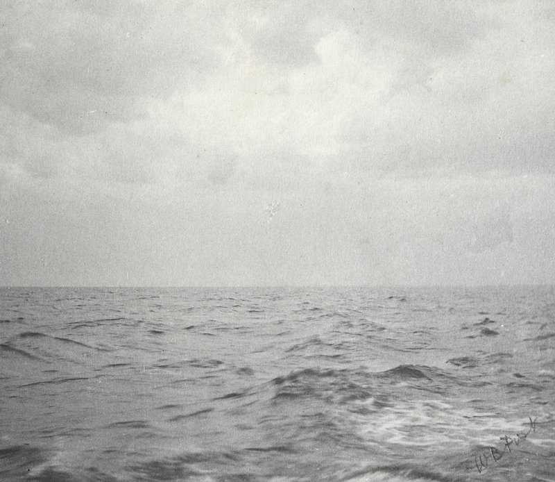choppy water; bright sky with clouds