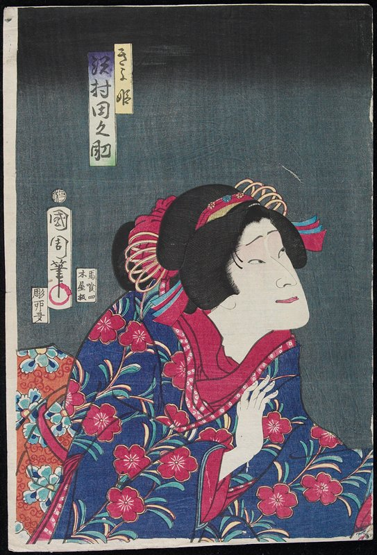 head and torso of figure dressed in blue robe with dark pink flowers and dark pink collar
