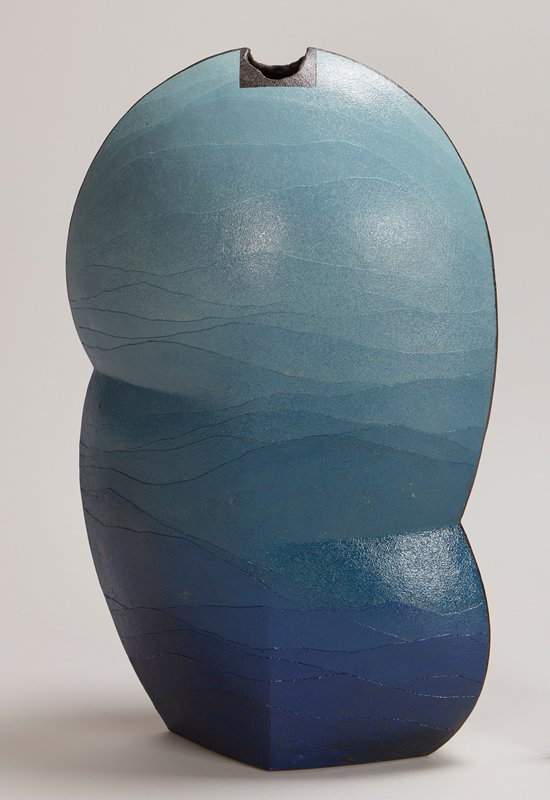 2 sharp edges with black at edges and mouth; horizontal, uneven striations in various shades of blue, lightening toward top