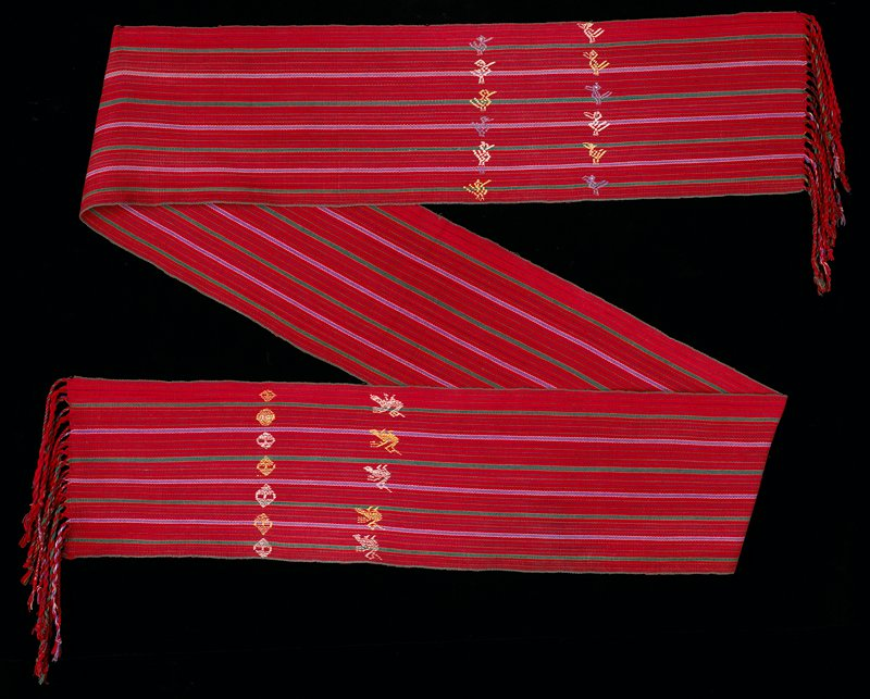 Striped sash with red background, white, blue and green stripes; birds and geometric pattern embroidered on each end; fringe
