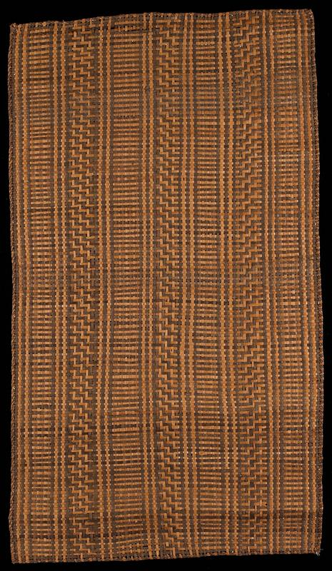 plant fiber woven mat; basket weave designs in two motifs, in alternating stripes; tan and brown; metal bar at one short end