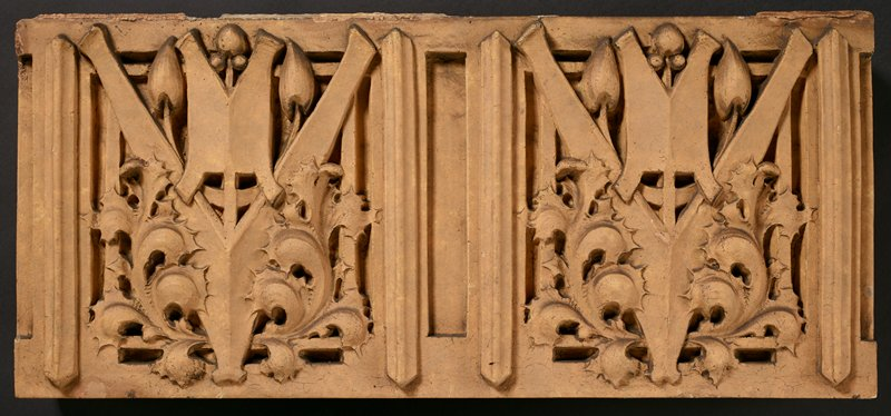 tan panel with two designs of scalloped leaves, buds and geometric designs; symmetrical decorations