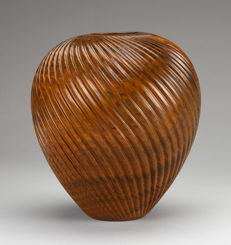 vessel with small flat foot, flaring outward and in again at steep shoulder; flush mouth; curved ribs over body