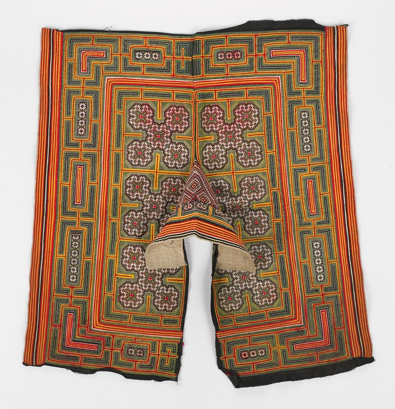 collar/ shoulder covering; applique and cross-stitch embroidery on black; predominantly red and yellow with green embroidery; lines and geometric abstracted floral shapes, scrolls and squares