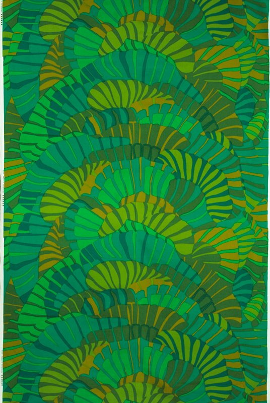 Abstract design with flowing shapes in green.