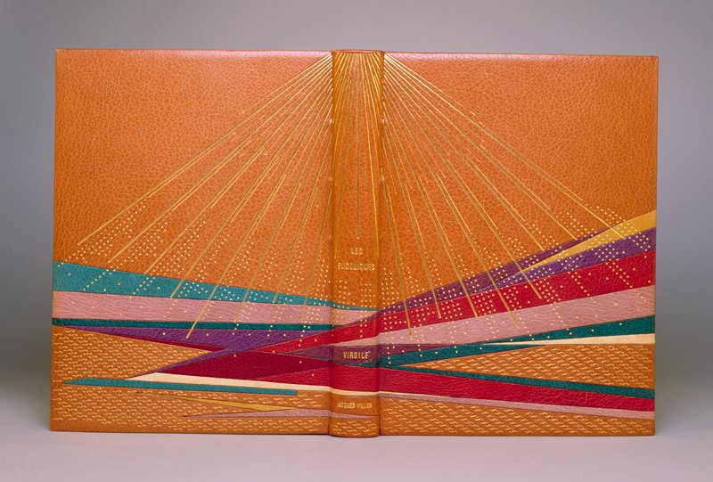 binding: tan leather with color leather inlays; endpapers: mauve silk; slip case: Box: marbled paper, edged in leather; type: Didot developed for this edition