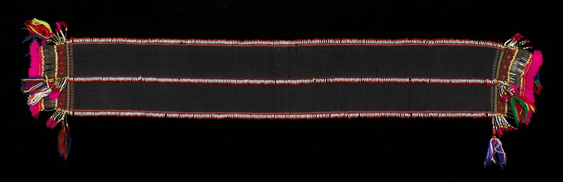 Black band, edges with beads, at center row of beads, at each end some geometric motifs, and rings with beads, glass beads and tassels, pink, green blue, yellow, red, purple