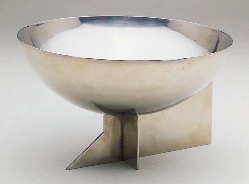 Bowl on a triangular pedestal