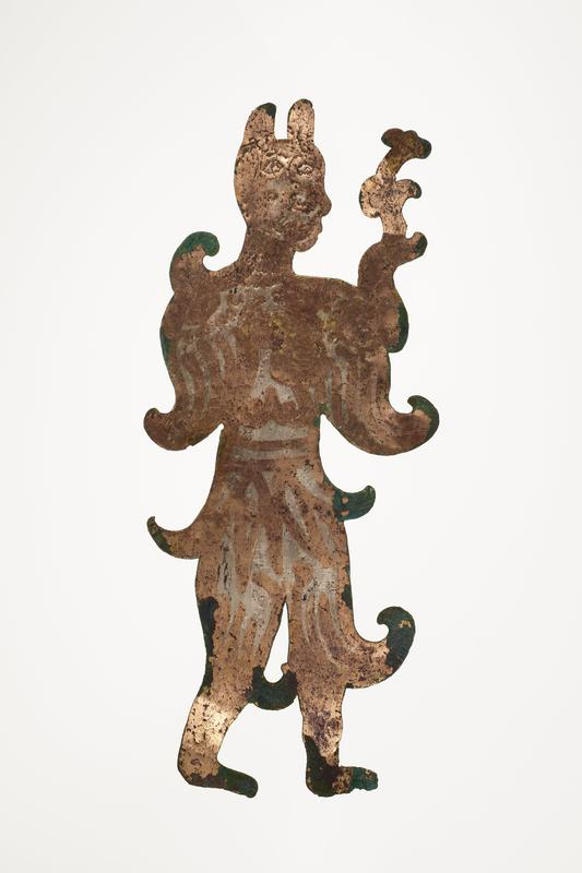 standing figure holding a flower-like object; facing R; incised details; mounted on black cloth-covered board with L2003.116.9.2