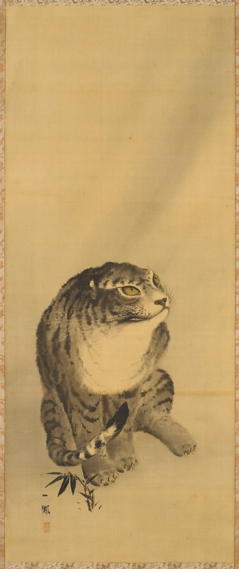 seated tiger with no ears visible; gold brocade border