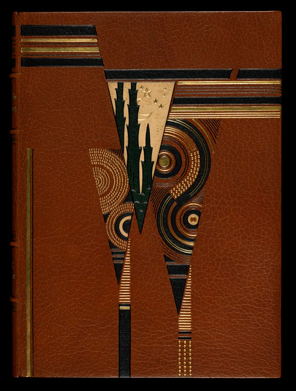 binding: tan leather with color-leather inlays; slip case: speckled paper slip case and cover guard edged in leather; 32 woodcuts in black and white and color and one printed a third time in color
