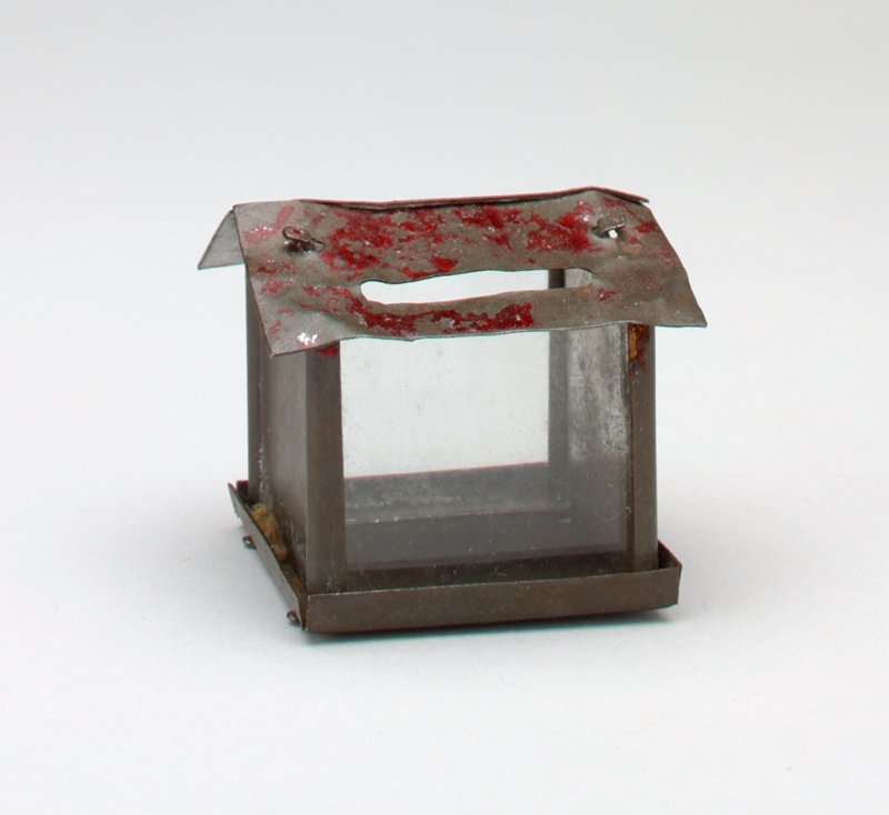 tiny bank with red metal roof; 2 sides metal, 2 sides glass