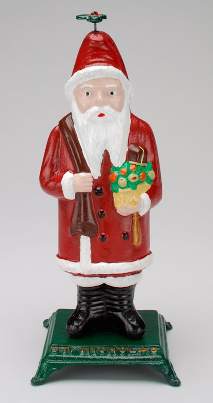 figure of St. Nicholas; elf with tray in sack on back pops up and down by pulling on holly on top of hat