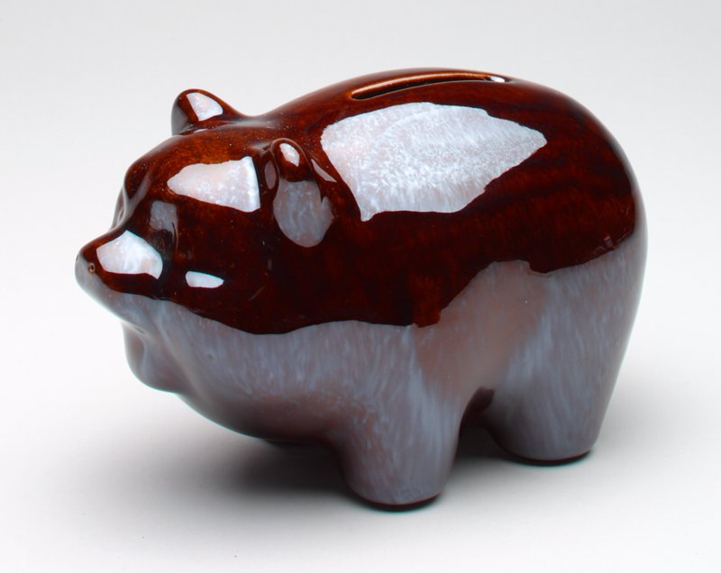 ceramic pig with irridescent decorative brown shiny glaze; circle for a tail; incised, indented nostrils on nose