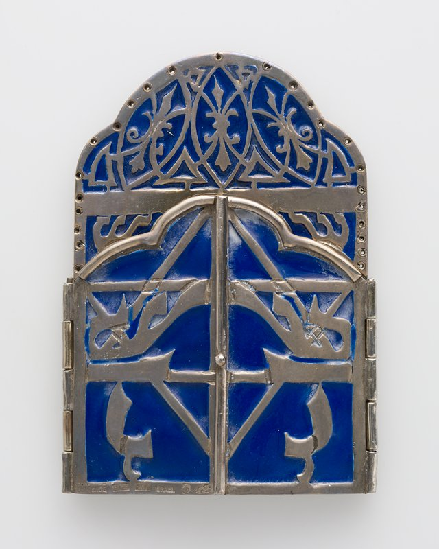 flat case with 2 doors which open to reveal 2 papers with texts, sealed in plastic bag; case decorated with blue enamel inlay in Hebrew letters (?) and organic designs