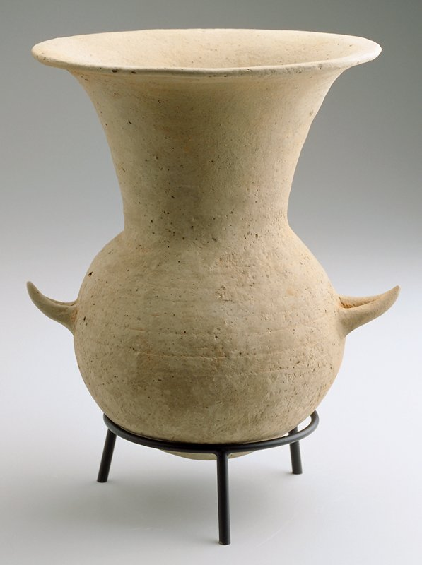 round-bottomed jar with neck opening into flaring lip; two small v-shaped handles below neck on body; has own stand