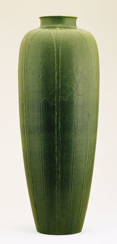 Tall vase decorated with stylized leaves and buds on dark green matte glaze