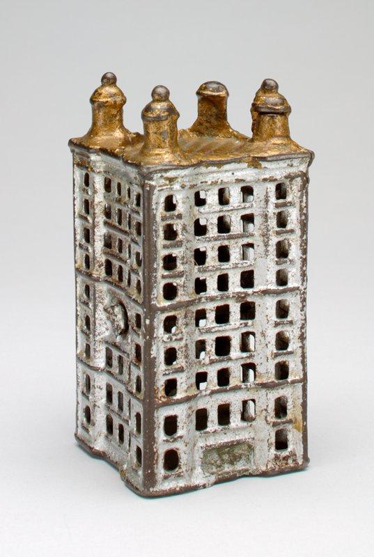 silver and gold skyscraper with corner turrets; medium