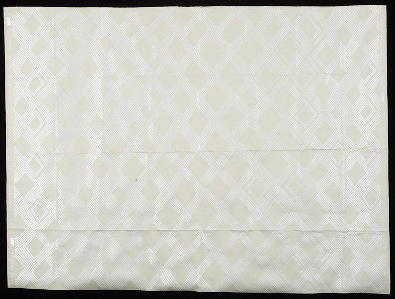"Geometric pattern of shiny rectangles set diagonally in varied linear motifs. Vert. Rpt. 32""; horiz. Rpt. 48"". White & tan. Soapstone"