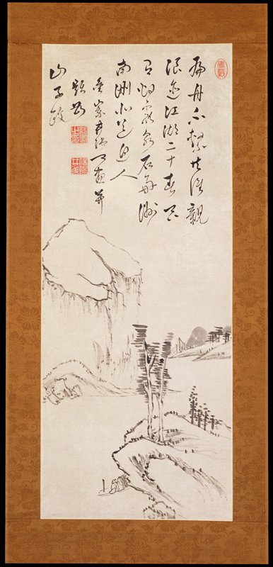 towering plateau dominates the landscape to the left; winding river flows around a small peninsula at LRC; a man in a boat sits to the left of the peninsula along the shoreline