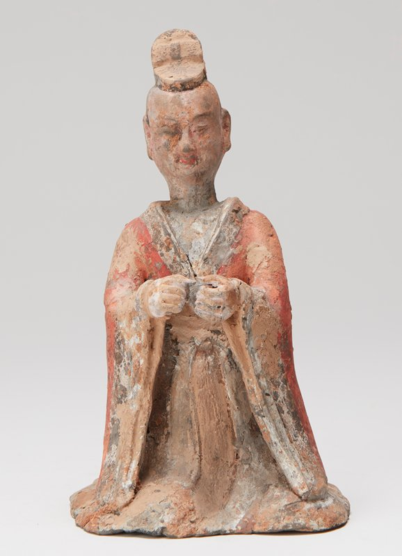 Figure of Buddhist priest (?) with hands extended - red polychrome on robe.