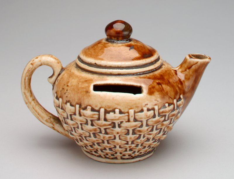 Ceramic brown teapot, basketweave decoration around the bottom section;