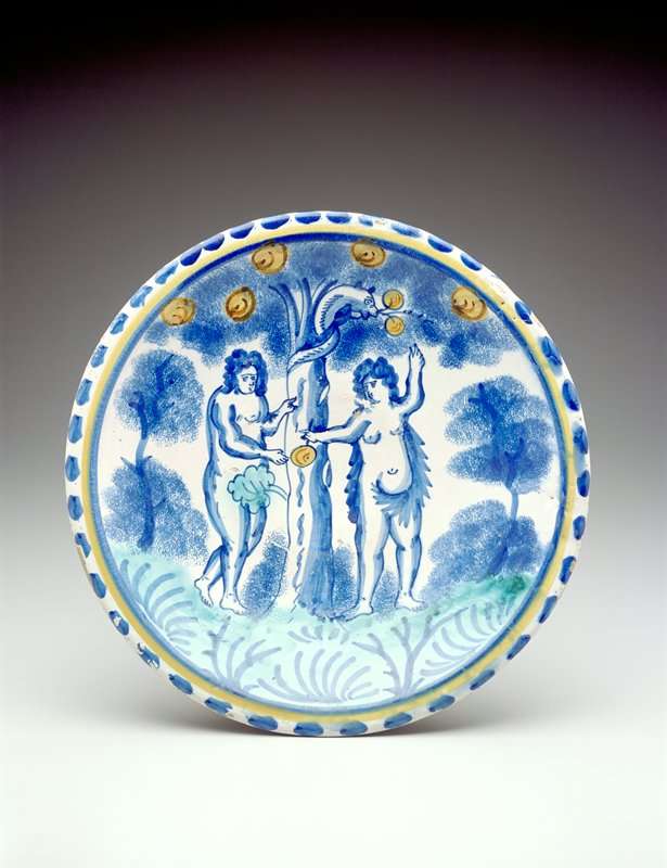 blue polychromed charger, image of Adam and Eve eating an apple from a tree entwined by a snake