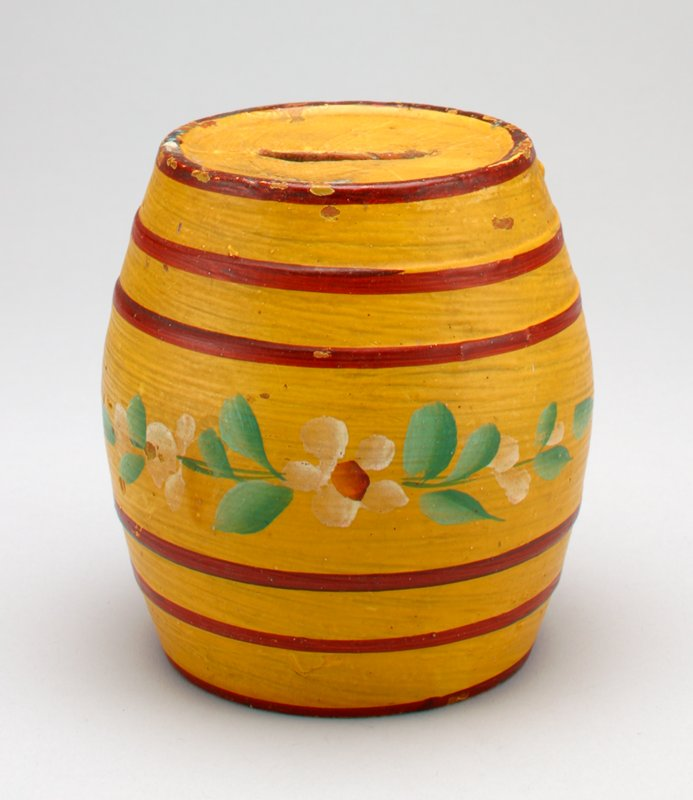 red lines around barrel fromtop to bottom; flowers painted in center yellow band; brush strokes clearly visible in pigment;