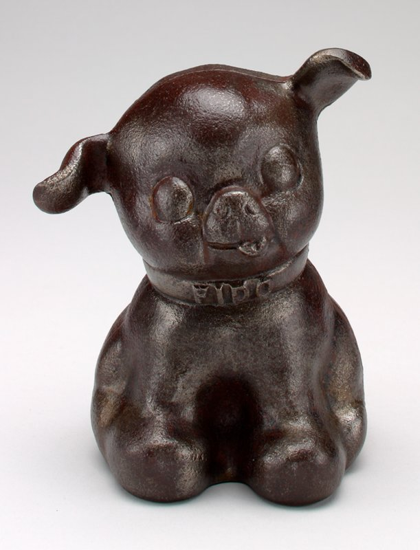 seated brown dog; coin slot in back above collar