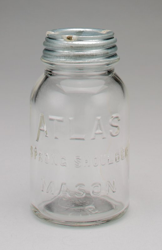 clear glass Atlas mason jar with silver colored metal cover
