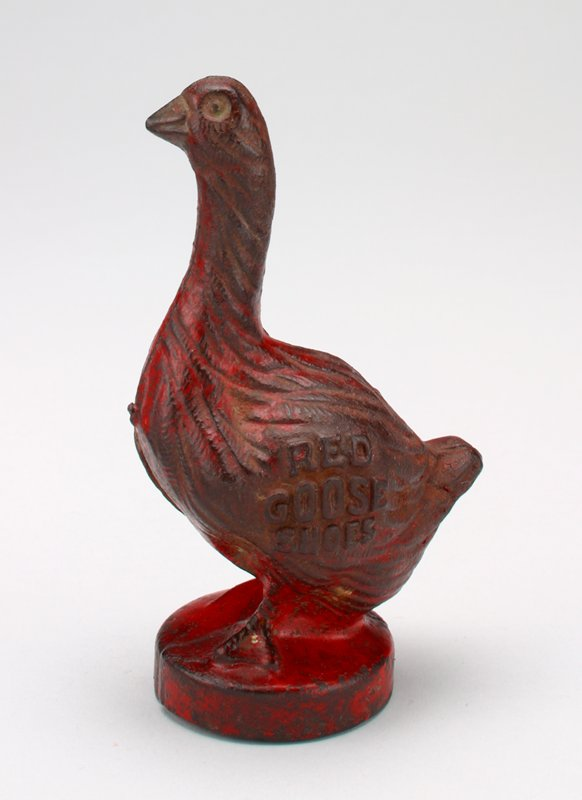 red metal goose; coin slot in back